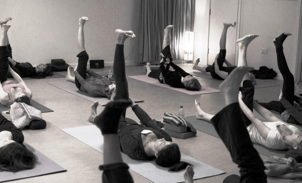 a group yoga class with beginners