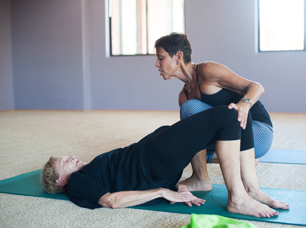 yoga teacher with student