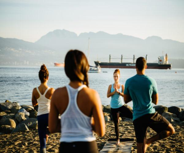 a yoga class on Kits beach in Vancouver