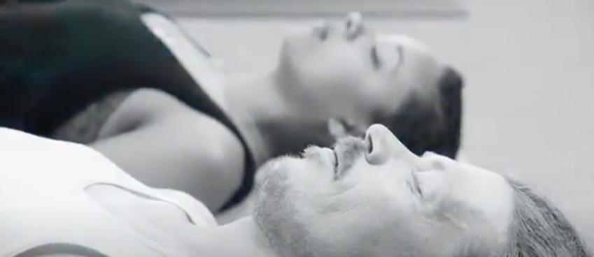 students in corpse pose in a yoga teacher training program