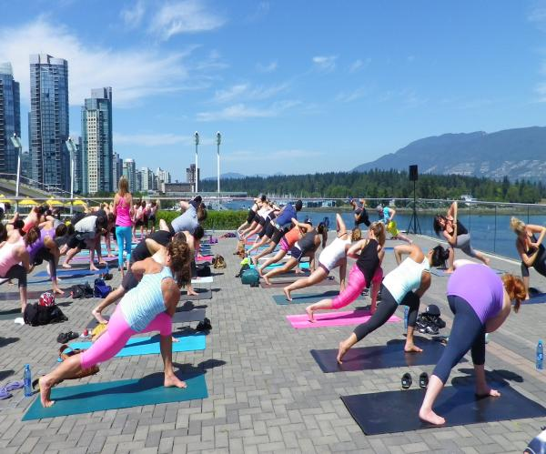 yoga class outside at the vancouver covention center