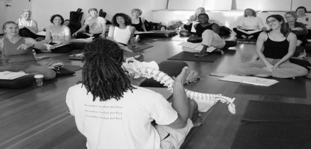 yoga teacher lecturing at yoga teacher training