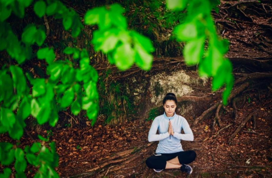 lady in the woods mediating for enlightenment