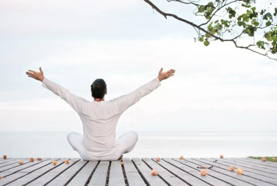 person meditating on a dock for enlightenment